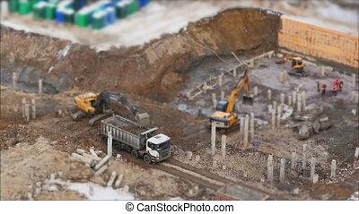 Excavator loading  soil in truck