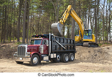 Excavator loading truck - Excavator loading dumper truck...