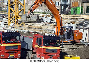 Excavator loading trucks