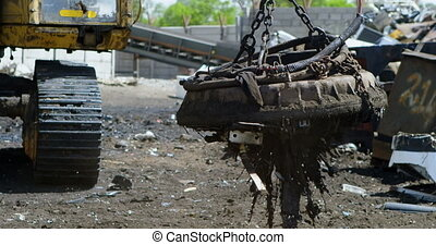 Close-up of excavator machine being operated in the junkyard 4k