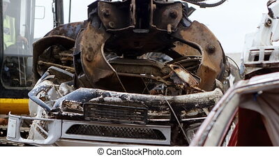 Excavator machine being operated in the junkyard 4k -...