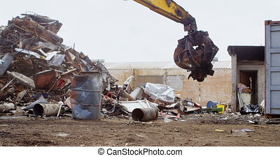 Modern excavator machine being operated in the junkyard 4k
