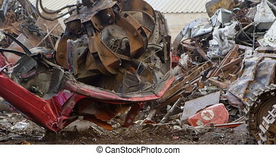 Excavator machine being operated in the junkyard 4k - Modern...