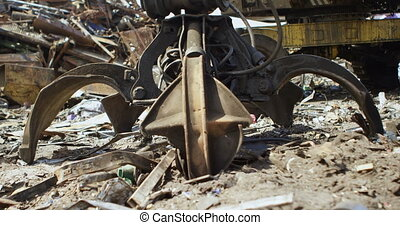 Excavator machine in the junkyard 4k - Close-up of excavator...