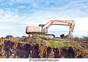 Excavator machine moves with raised bucket on construction...