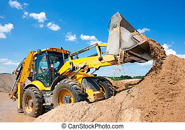Excavator machine unloading sand during earth moving works...