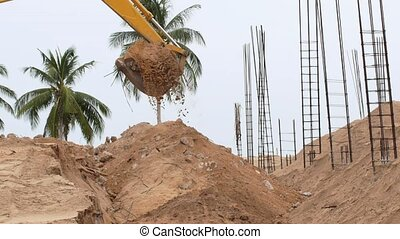 Excavator Machine with Bucket Working on Construction Site. Slow Motion.
