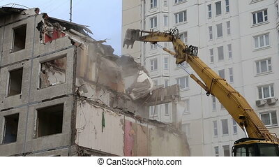 demolition old house - Excavator machinery working on...