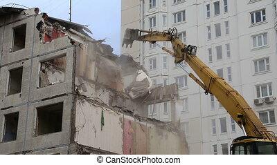demolition old house - Excavator machinery working on...