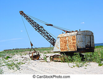 Excavator on a background of sand