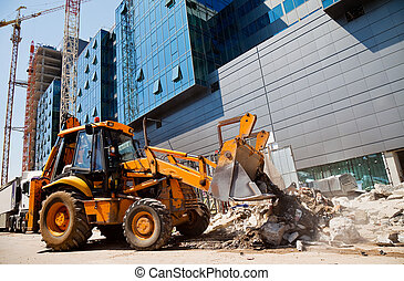 excavator on a construction site - excavator is digging...