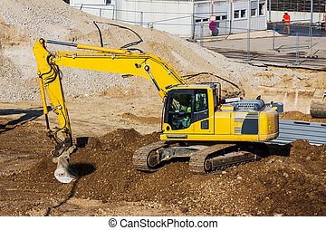 excavator on construction site during excavation