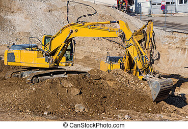 excavator on construction site with earthworks - excavator ...