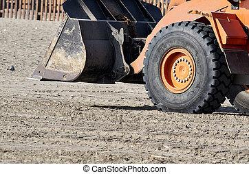 excavator on the beach