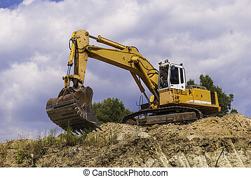 Excavator on the construction site is preparing to load the soil