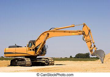 Excavator - Orange excavator at construction site