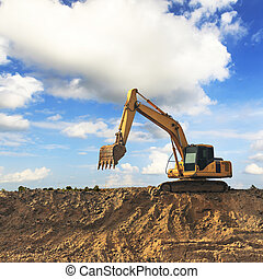 Excavator with blue sky