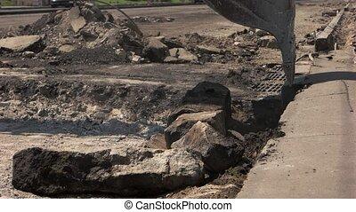 Excavator scoop in motion. Machine breaks concrete. Demolish...
