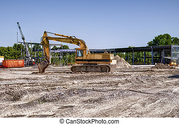Excavator on construction site, steel structure in...