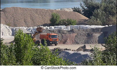 Excavator, truck