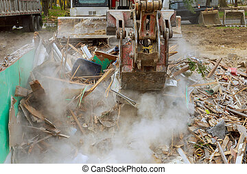Excavator with crusher house demolition after hurricane