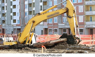 Excavator working at building site