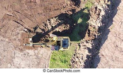 excavator working summer sunny day aerial shot.