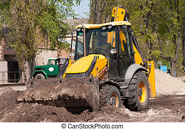 excavator works with the earth closeup