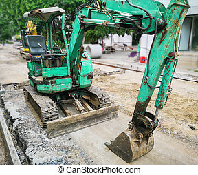Excavators with tanks at the road construction area
