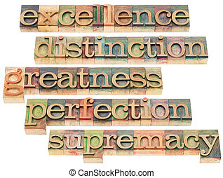 excellence, distinction, greatness, perfection and supremacy - a collage of isolated words in letterpress wood type blocks stained by color inks