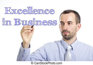 Excellence in Business - Young businessman writing blue text on transparent surface