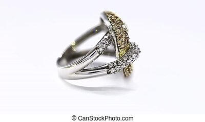 Excellence Ring in Yellow and White Gold and Diamonds Turning on Themselves Against a White Background