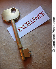 Excellence - Close up of a golden key with excellence label
