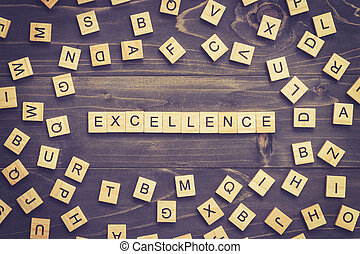 Excellence word wood block on table for business concept.