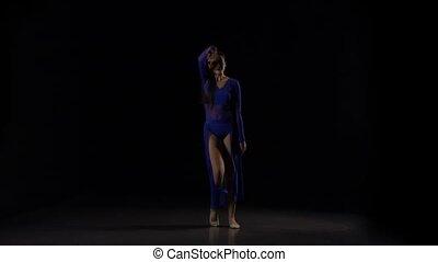 Excellent ballerina dancing a modern ballet. Slow motion -...