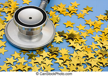 Excellent Healthcare - A pile of gold stars and stethoscope...