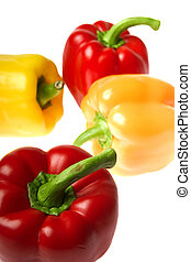 excellent red and yellow peppers on a white background