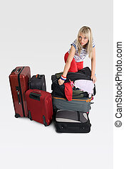 Excessive luggage - Woman with many bags and suitcases