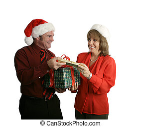 Exchanging Gifts - A man and a woman in business attire...
