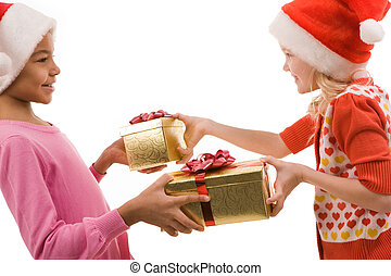 Exchanging gifts - Portrait of happy friends exchanging...