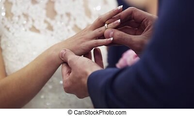 Exchanging of wedding rings - Two white people groom and...