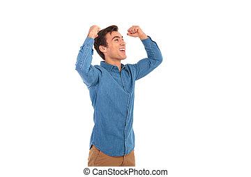 excité, désinvolte, homme, célébrer, reussite, à, mains haut