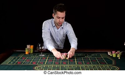Excitable guy playing poker. Black