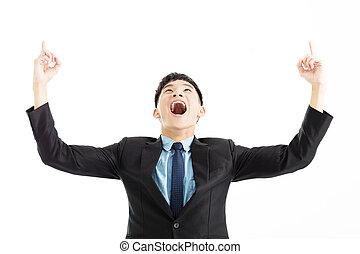 excitado, hombre de negocios, celebración, éxito, con, señalar con el dedo arriba