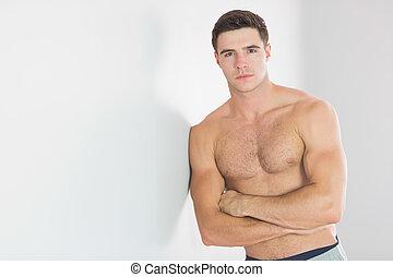 excitado, homem, bonito, topless, inclinar-se