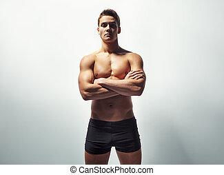 excitado, homem, jovem, muscular, retrato