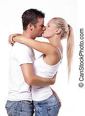 excitado, par, jovem, beijando
