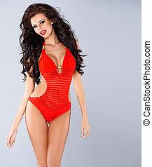 excitado, sensual, morena, posar, em, vermelho, swimsuit