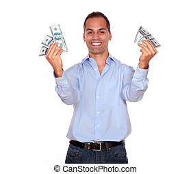 Excited adult man holding cash money