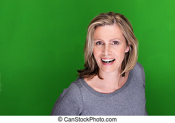 Excited attractive middle-aged woman